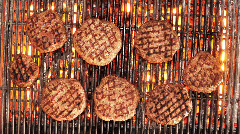The author's venison burgers, fired up on the grill.