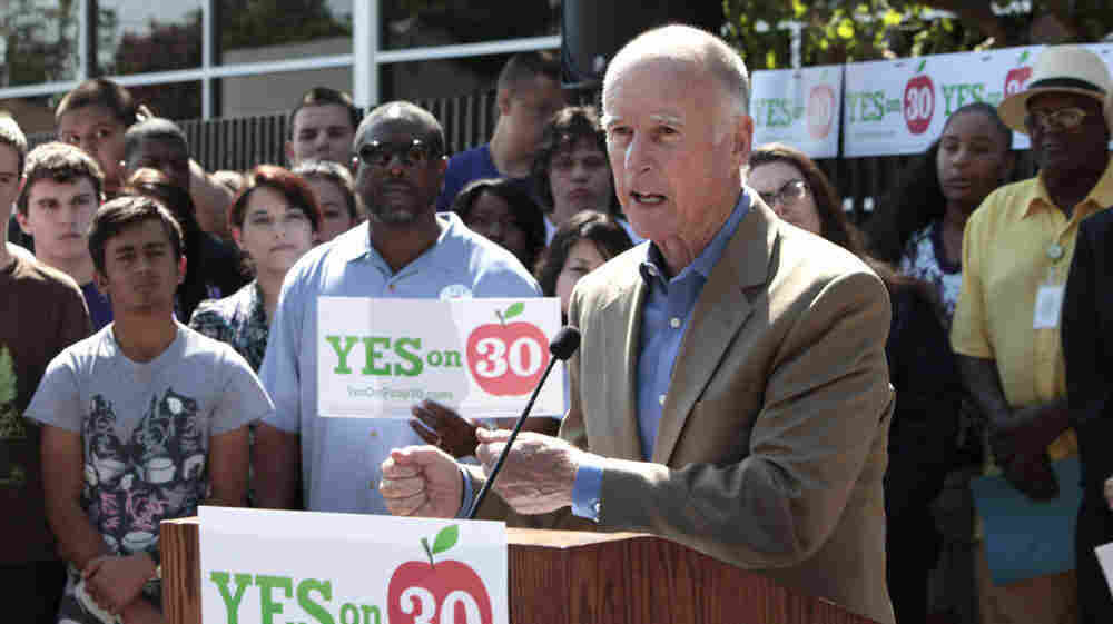 California Gov. Jerry Brown, speaking in Sacramento on Wednesday, advocates a ballot initiative that would increase sales and income taxes. Several states have measures on the November ballot that seek to plug deficits by raising taxes.