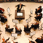 The Atlanta Symphony Orchestra is facing budget battles, and the shame of being silenced while backing a pop group.