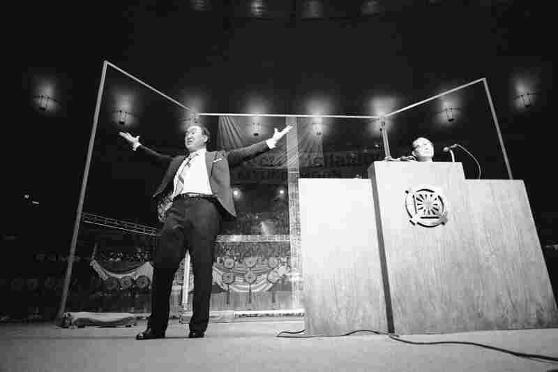 Moon appears before a capacity crowd of 2,000 in 1974 in New York's Madison Square Garden, where he preached for the rebirth of Christianity. His appearance was part of a 40-city U.S. tour that year.