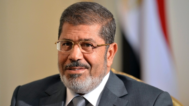 Egypt's new president, Mohammed Morsi, has promised to improve the lives of ordinary Egyptians during his first 100 days in office. But Morsi, shown here in July, is dealing with multiple challenges, including an economy that has been struggling since last year's revolution. (AFP/Getty Images)