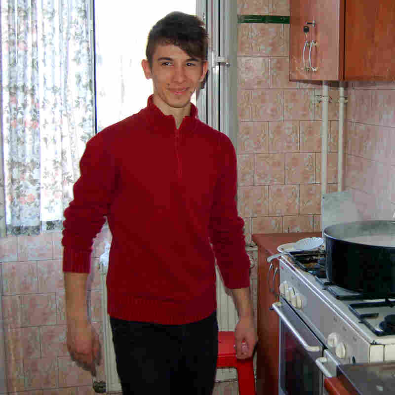 Many Romanian kids who grow up in orphanages lack life skills when they leave the institutions at age 18. At Grosuleac's home, boys go to school, get jobs and do household chores. Here, Emanuel prepares a rice dish for dinner.