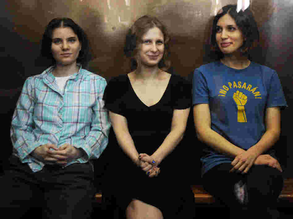 Members of the all-girl punk band Pussy Riot: Nadezhda Tolokonnikova (right), Maria Alyokhina (center) and Yekaterina Samutsevich (left) in a glass-walled cage during a court hearing in Moscow earlier today.