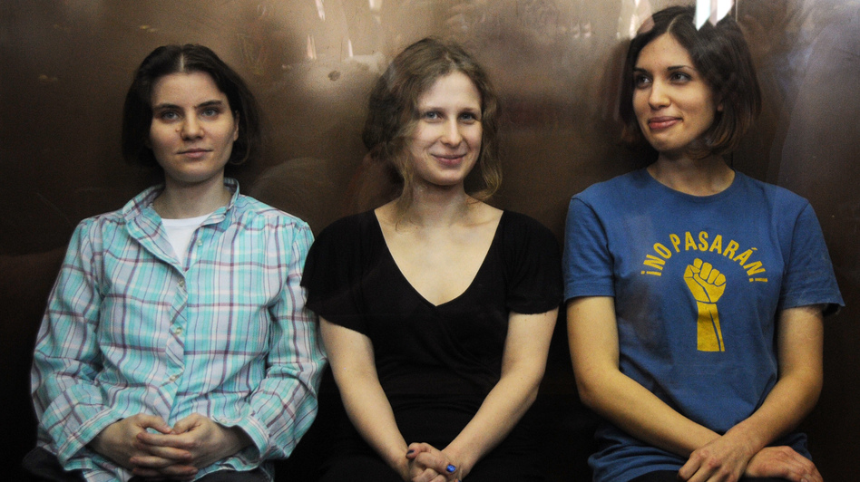 Members of the all-girl punk band Pussy Riot: Nadezhda Tolokonnikova (right), Maria Alyokhina (center) and Yekaterina Samutsevich (left) in a glass-walled cage during a court hearing in Moscow earlier today. (AFP/Getty Images)
