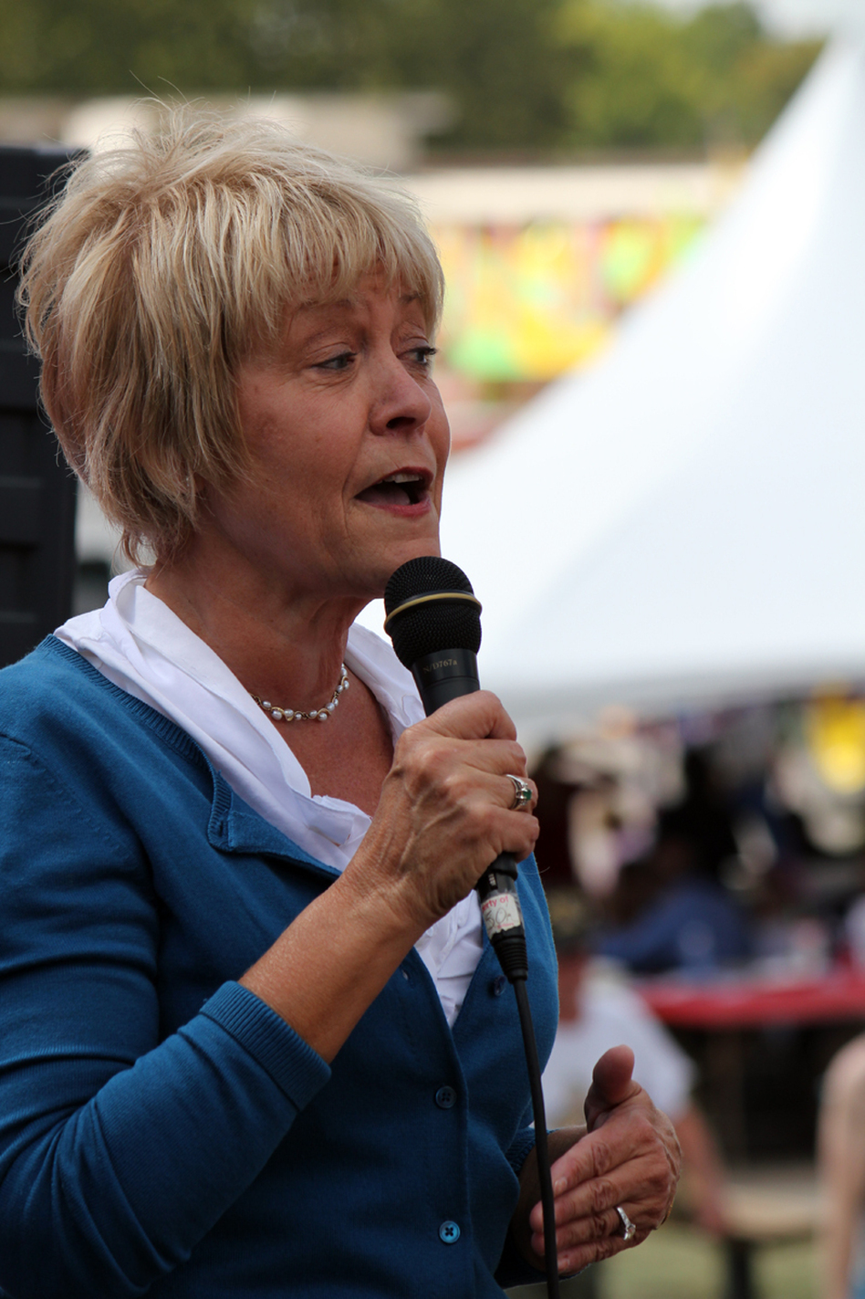 Former Iowa first lady Christie Vilsack speaks at a political soapbox at the Iowa State Fair in Des Moines. (Iowa Public Radio)