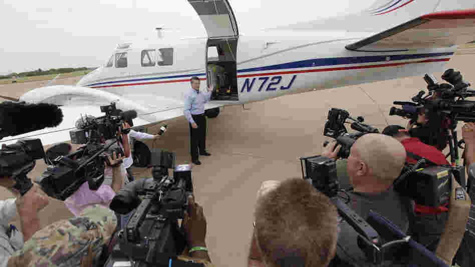 Mike Stuart of Dynamic Aviation speaks to the media this week about the type of plane used for aerial spraying in Dallas. The city and county are conducting aerial spraying to combat the nation's worst outbreak of West Nile virus, which has killed at least 10 people and sickened about 200.