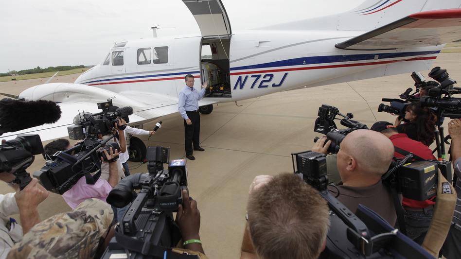 Mike Stuart of Dynamic Aviation speaks to the media this week about the type of plane used for aerial spraying in Dallas. The city and county are conducting aerial spraying to combat the nation's worst outbreak of West Nile virus, which has killed at least 10 people and sickened about 200. (AP)