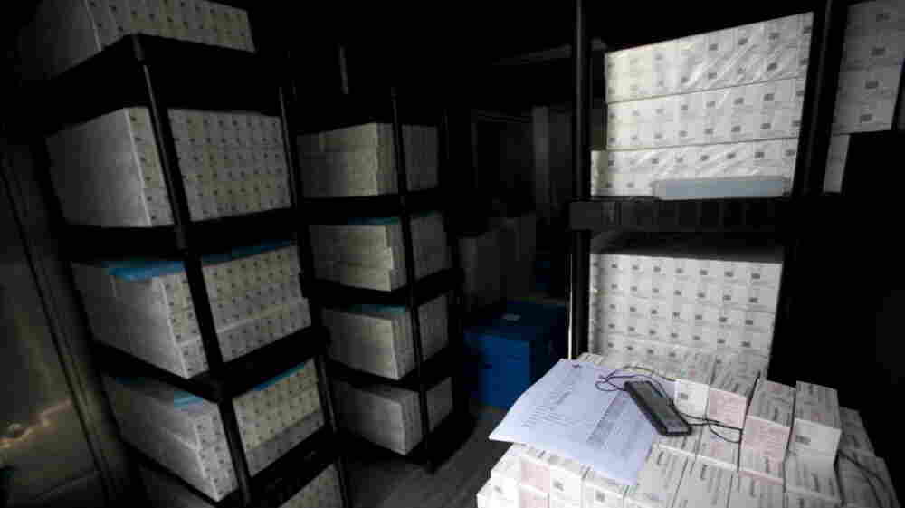 Thousands of doses of cholera vaccine sit in a refrigerated trailer in a United Nations compound in Saint-Marc, Haiti, in March. After some delays, a vaccination project proved successful.