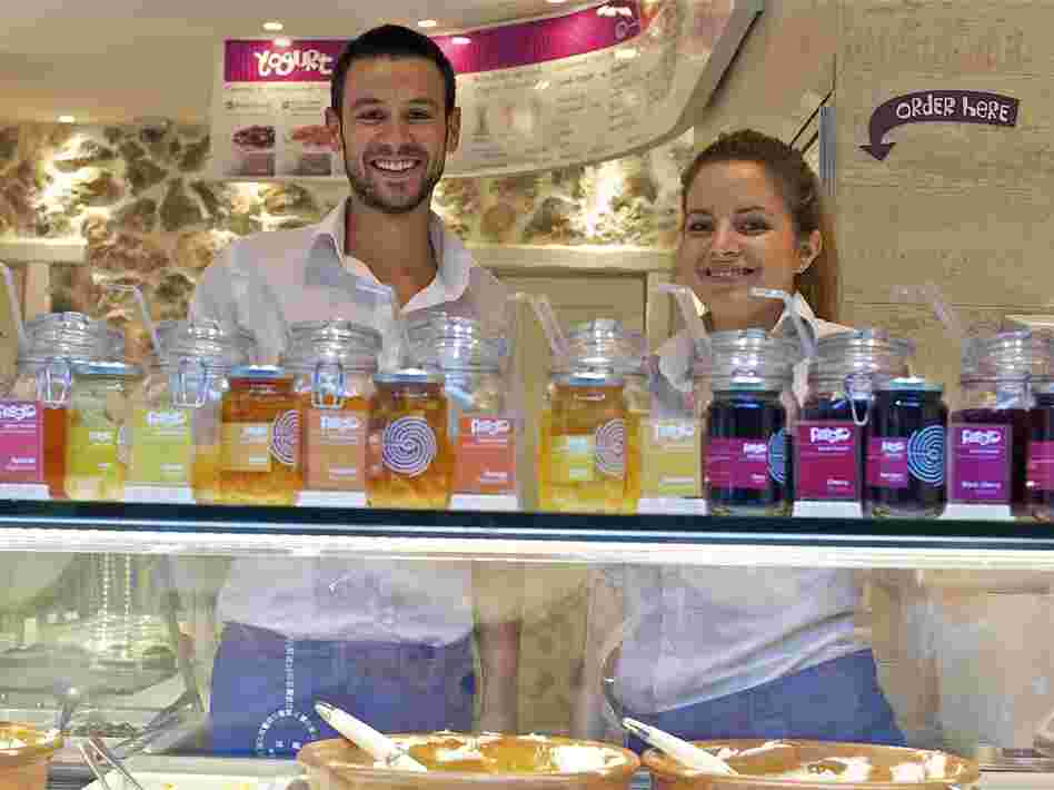 Dimitris Plassas and Georgia Ladopoulou work the yogurt bar at Fresko, which specializes in several varieties of Greek-style yogurt.