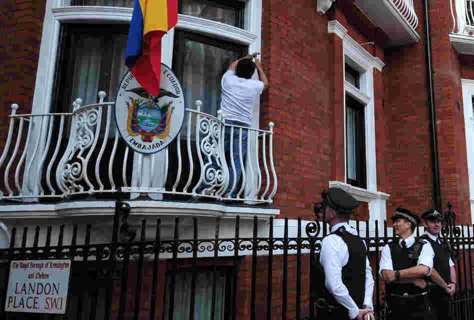 Police stand by near a balcony of the Ecuadorian embassy in London on Sunday.