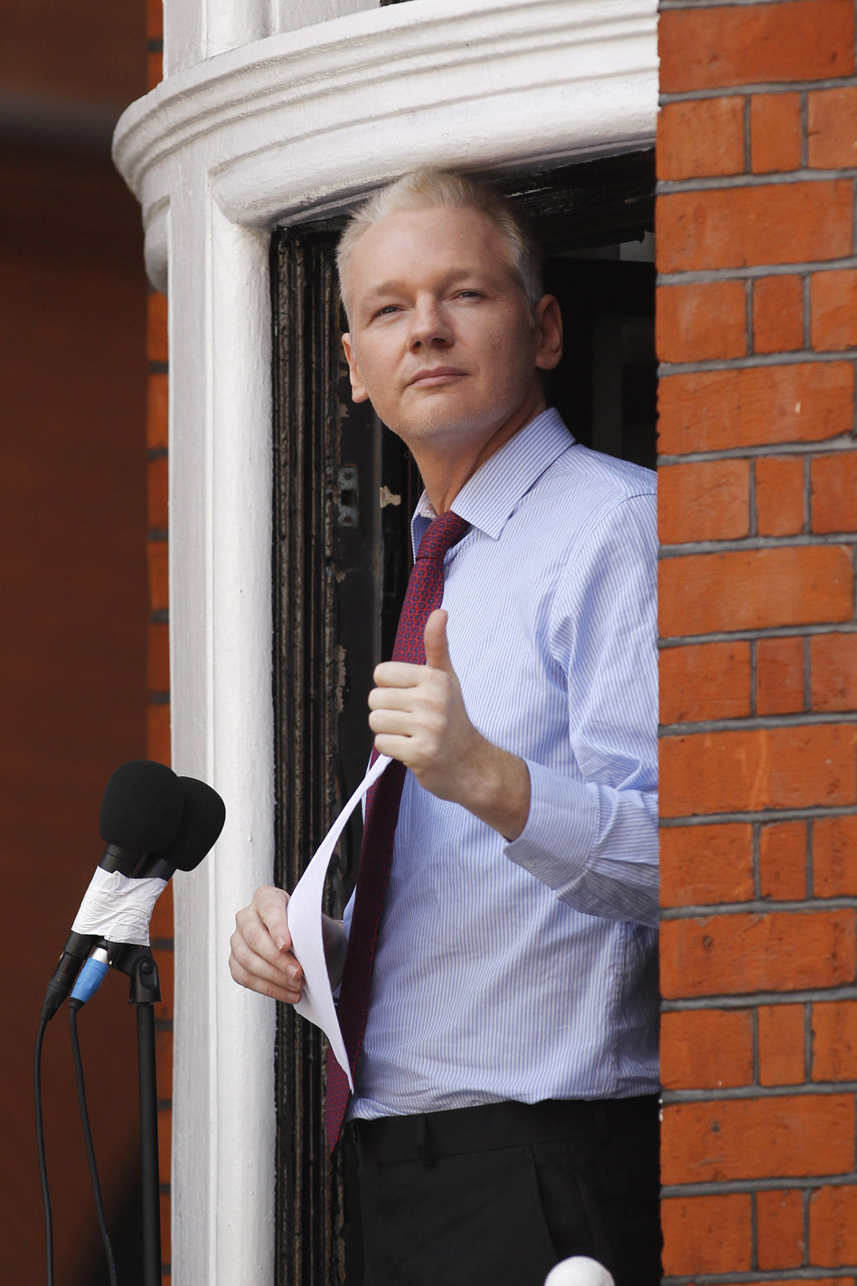 Julian Assange, founder of WikiLeaks, makes a statement from a balcony of the Ecuadorian embassy in London on Sunday.