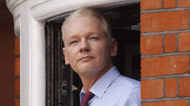Julian Assange, founder of WikiLeaks, makes a statement from a balcony of the Ecuadorian embassy in London on Sunday. (AP)
