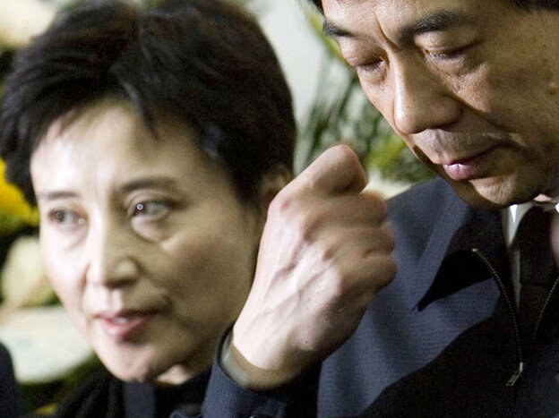 In this Jan. 17, 2007, photo, Gu Kailai, left, and her husband, Bo Xilai, attend a memorial ceremony for Bo's father. Gu was given a suspended death sen