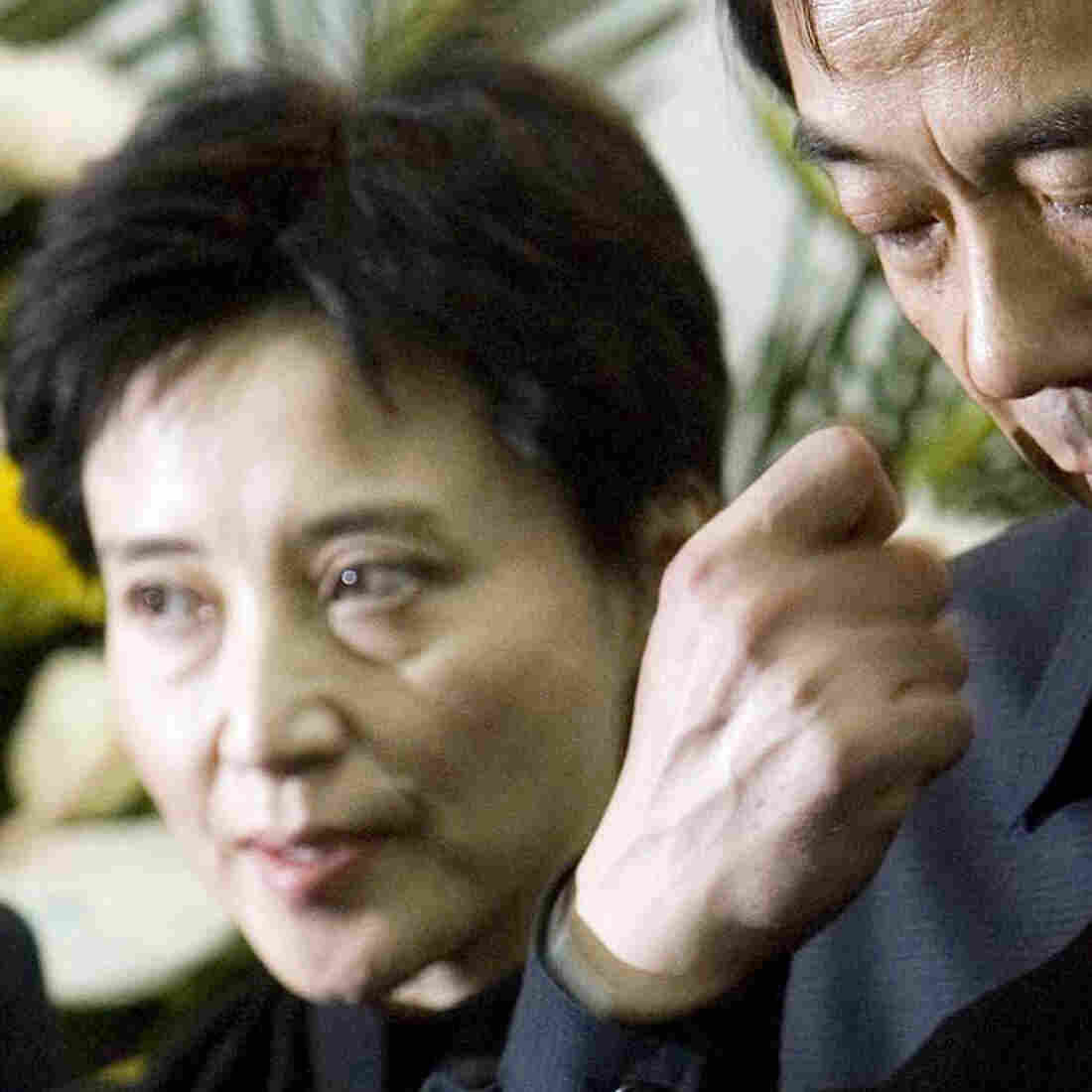 In this Jan. 17, 2007, photo, Gu Kailai, left, and her husband, Bo Xilai, attend a memorial ceremony for Bo's father. Gu was given a suspended death sentence Monday after confessing to killing a British businessman by poisoning him with cyanide.