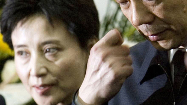 In this Jan. 17, 2007, photo, Gu Kailai, left, and her husband, Bo Xilai, attend a memorial ceremony for Bo's father. Gu was given a suspended death sentence Monday after confessing to killing a British businessman by poisoning him with cyanide. (AP)