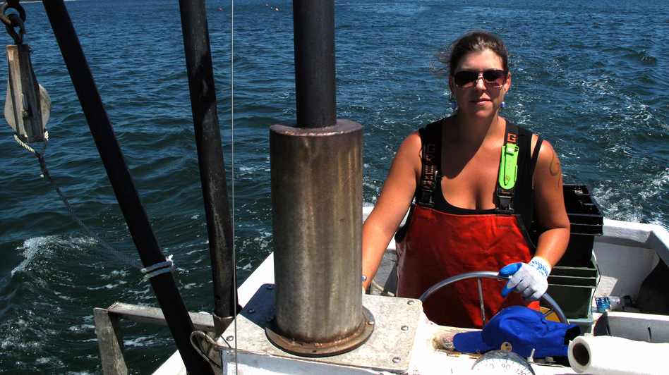 Genevieve Kurilec pilots her boat, Hello Darling, near the coastal waters of Maine. Kurilec, 29, has worked on or around boats since graduating high school. (NPR)