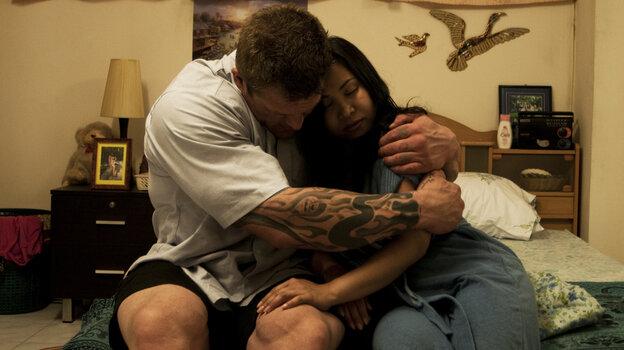 Bodybuilder Dennis (Kim Kold) and gym owner Toi (Lamaiporn Sangmanee Hougaard) share a tender moment.