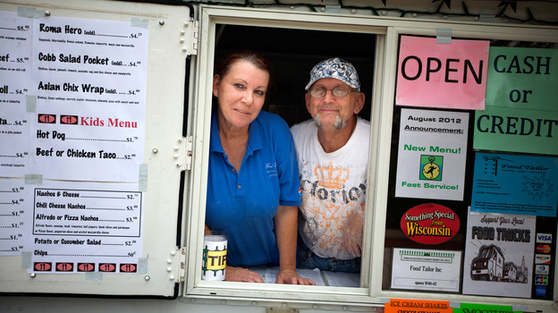 Patricia and Steven Cumber run the Food Tailor food truck in downtown Oshkosh, Wis. It's their primary source of income after Steven lost his job as a welder. (NPR)