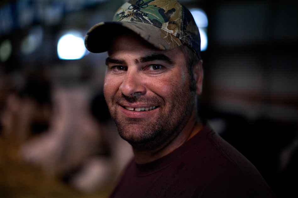 "Charlie Knigge is a dairy farmer from Omro, Wis. He talked to NPR at the Winnebago County Fair in Oshkosh. ""I'm not a big fan of how big the government's gotten or how many people are living off the government now,"" he says."