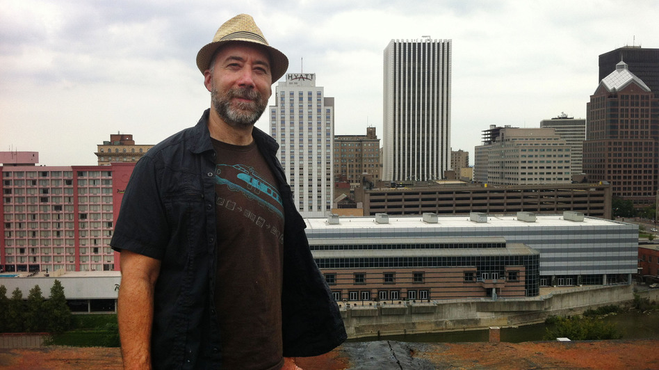 Adam Frank stands atop of the Wilder Building in Rochester, N.Y. (WXXI)