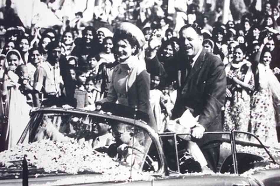 Then-first lady Jacqueline Kennedy visited Pakistan in 1962. Here she is seen riding in a convertible with the then-ruler of Pakistan, Ayub Khan, through throngs of people in Karachi.