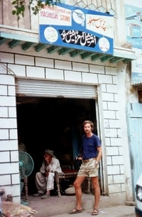 A German tourist stands outside a hashish shop in 1976. Shops selling hashish sprang up in northwestern Pakistan when young Western tourists began to pour in from Afghanistan in the late 1960s.