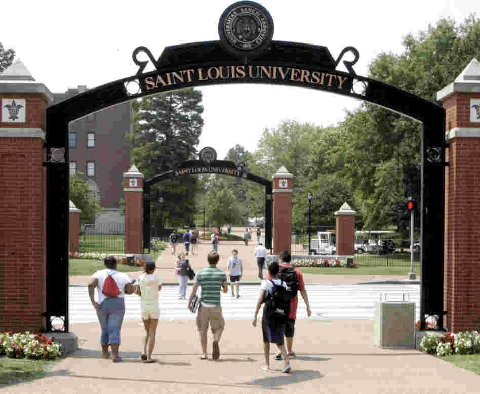 Persons walk across the campus of Saint Louis University in St. Louis in 2006.