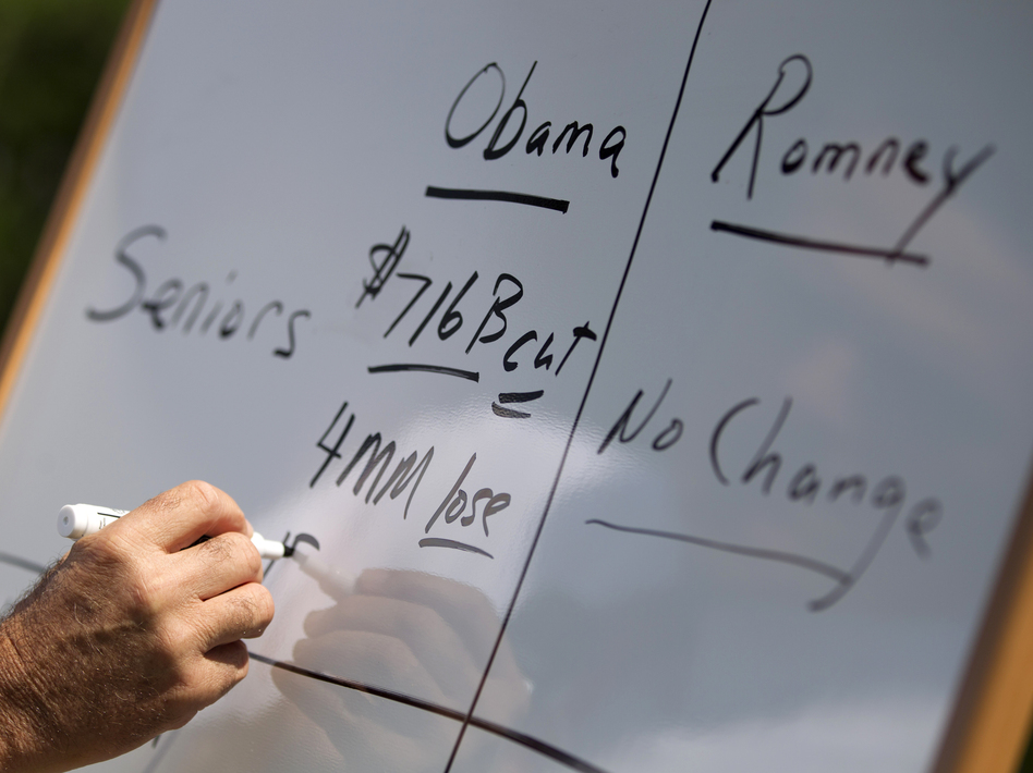 Mitt Romney writes on a whiteboard as he talks about Medicare during a news conference on Aug. 16 in Greer, S.C. (AP)