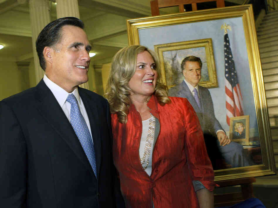 Former Massachusetts Gov. Mitt Romney and his wife, Ann, greet guest