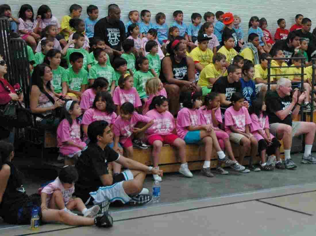 A rainbow of teams at basketball camp.