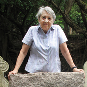 For more than a decade, author Patricia Lim researched the 8,000 graves of the Hong Kong Cemetery, one of the city's oldest Christian cemeteries. Here, Lim stands at the grave of former Hong Kong police officer Richardson Barry Loxley Leslie. Last year, she rested on the grave while, unbeknownst to her at the time, she was having a mild heart attack.