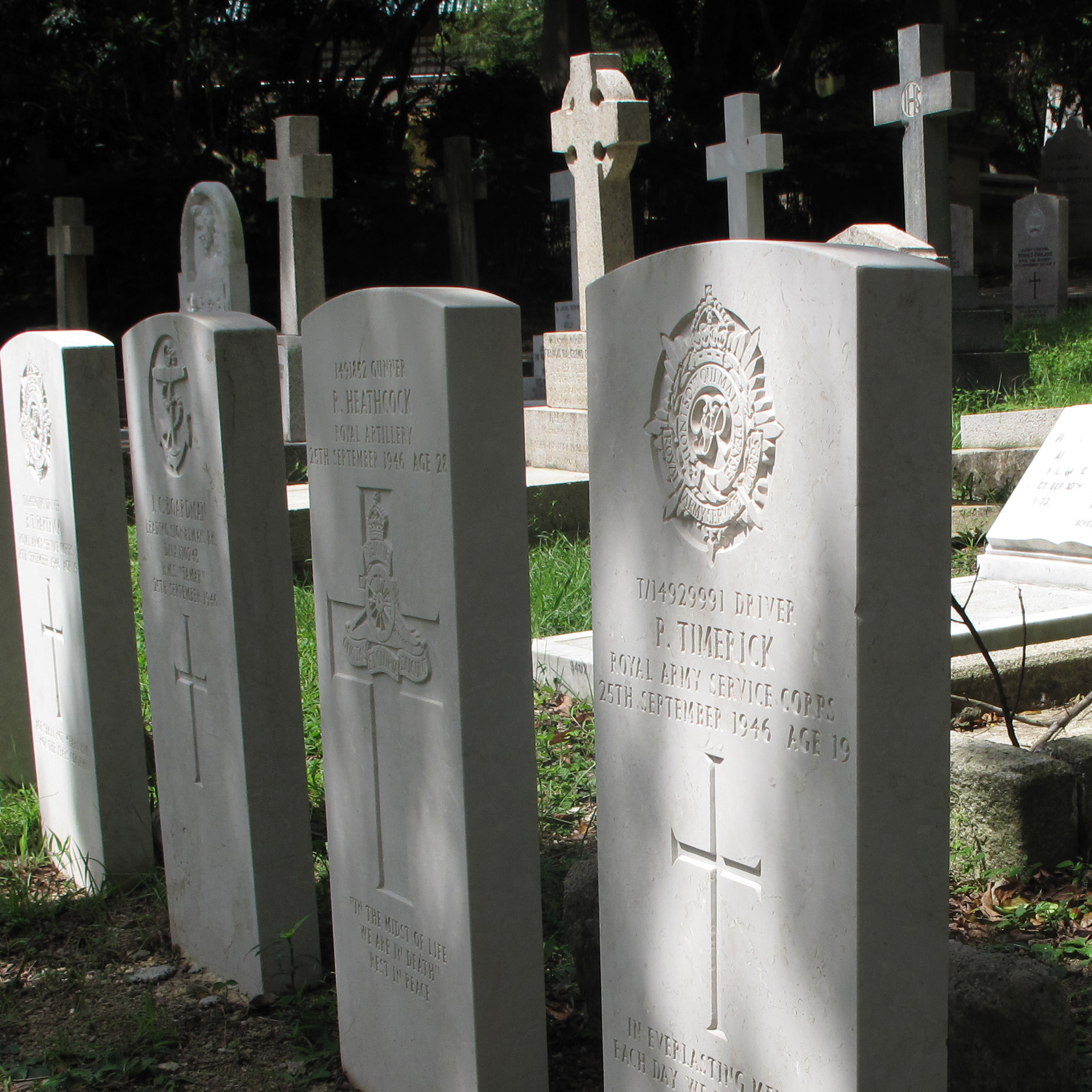 A series of identical graves mark the resting spots for 11 British soldiers, including Col. Cyril Wild. His plane crashed in 1946 en route to Tokyo,where he was heading to give evidence against Japanese army officers at the Tokyo War Crimes Tribunal. He'd been the only fluent Japanese speaker in the British army, and he helped negotiate the Japanese surrender in Singapore.