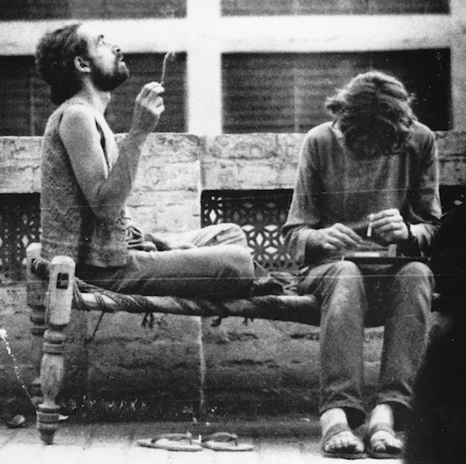 "Western tourists smoke hashish on the roof of a hotel in Peshawar in 1972. Pakistan was an important destination along the ""hippie trail,"" a popular route for young Western backpackers that ran across Turkey, Iran, Afghanistan, Pakistan and India, usually ending in Nepal."