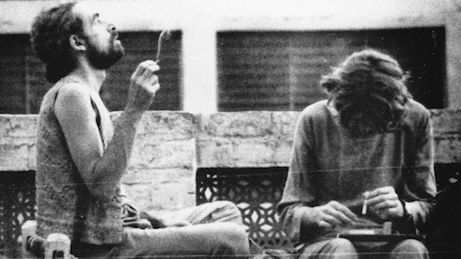 "Western tourists smoke hashish on the roof of a hotel in Peshawar in 1972. Pakistan was an important destination along the ""hippie trail,"" a popular route for young Western backpackers that ran across Turkey, Iran, Afghanistan, Pakistan and India, usually ending in Nepal. (Courtesy of Nadeem F. Paracha)"