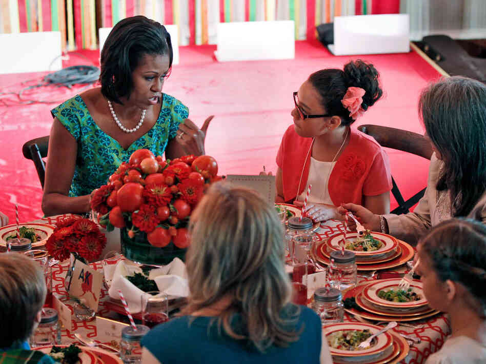 First Lady Michelle Obama chats with Illana Gonzales-Evans from Washington at the first Kids State Dinner.