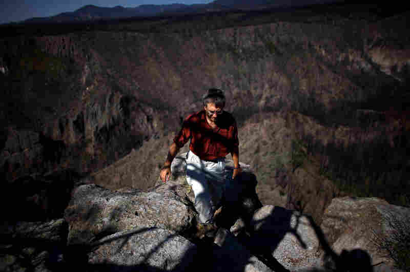 Craig Allen, a research ecologist with the U.S. Geological Survey, walks up a bluff overlooking Cochiti Canyon, which was destroyed by last year's Las Conchas megafire.