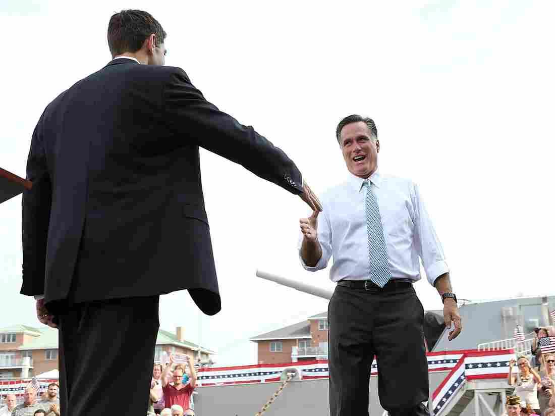 Republican Presidential Candidate Gov. Mitt Romney welcomes running mate Rep. Paul Ryan on stage in Norfolk, Va.