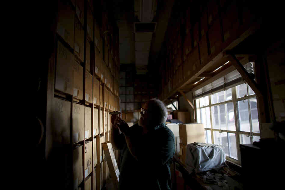 Swetnam stands in the catacombs of storage boxes that house thousands of tree-ring samples. His laboratory is buried under the bleachers of the University of Arizona football stadium.