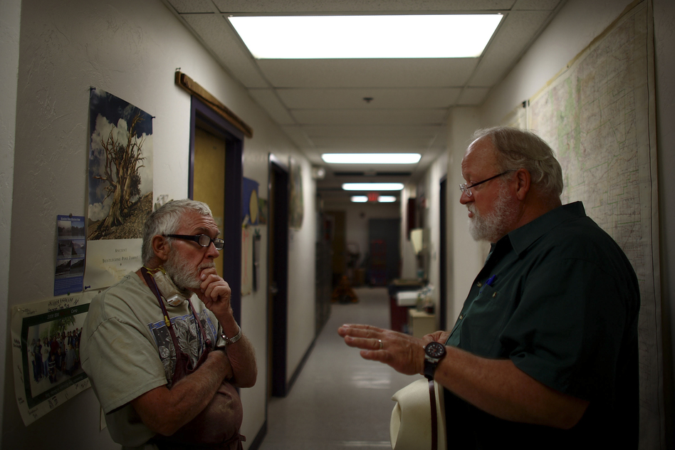Adams (left) talks with Swetnam in their laboratory, nestled under the football stadium. (NPR)