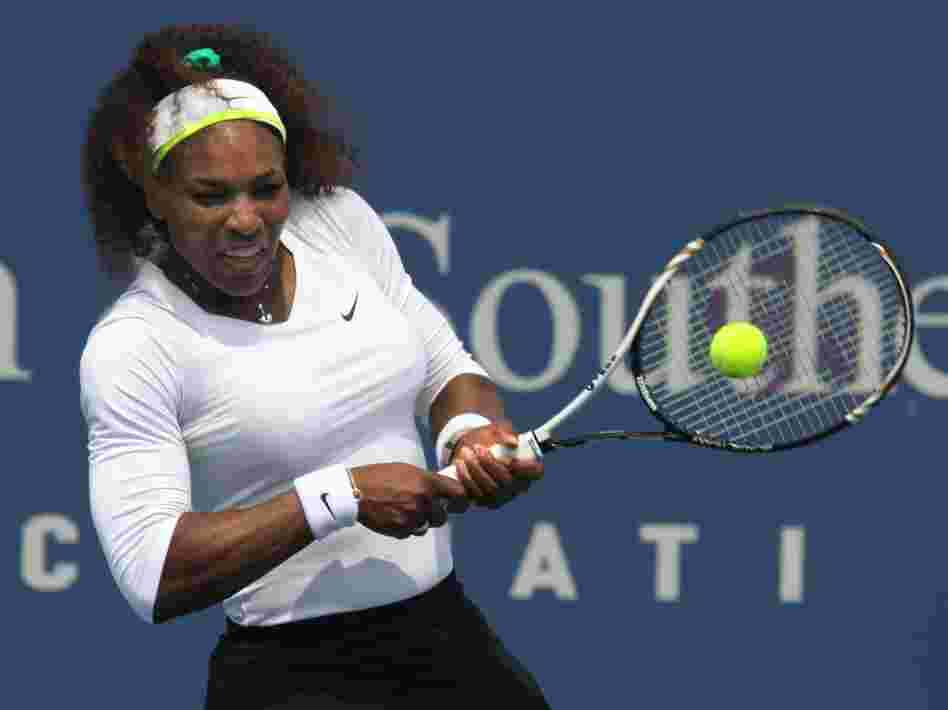 Serena Williams returns a shot during a match at the Western & Southern Open tennis tournament in Mason, Ohio.