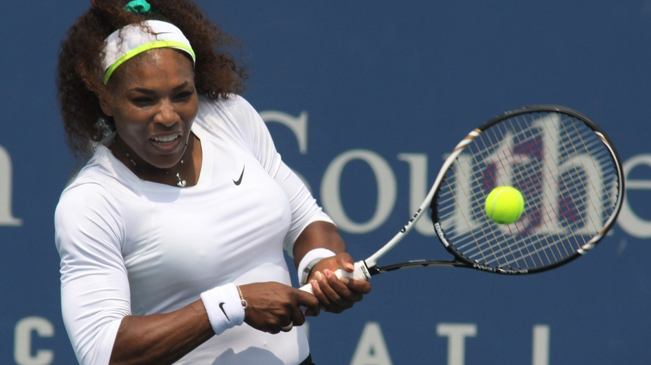 Serena Williams returns a shot during a match at the Western & Southern Open tennis tournament in Mason, Ohio. (AP)