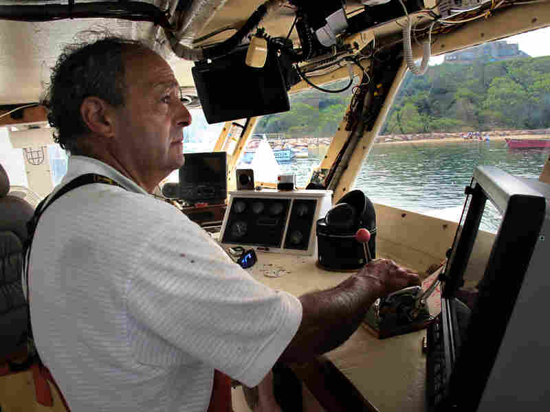 Boat captain Bill Amaru pilots his trawler, the Joanne-A III, to its mooring in Chatham Harbor on Cape Cod after a cod fishing trip.