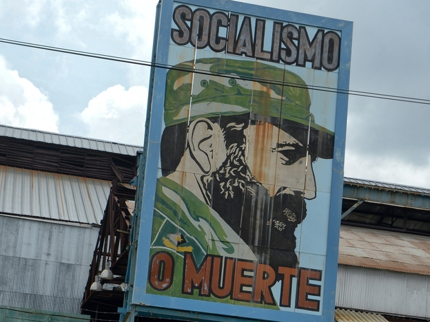 Cubans pass by a billboard celebrating the 86th birthday of former Cuban President Fidel Castro, on Aug. 13 in Havana. Castro celebrated his birthday quietly and out of the public eye, while political allies and Cuban citizens paid tribute from afar.