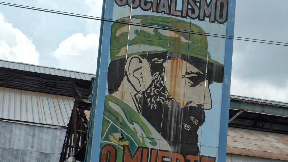 Cubans pass by a billboard celebrating the 86th birthday of former Cuban President Fidel Castro, on Aug. 13 in Havana. Castro celebrated his birthday quietly and out of the public eye, while political allies and Cuban citizens paid tribute from afar. (AFP/Getty Images)
