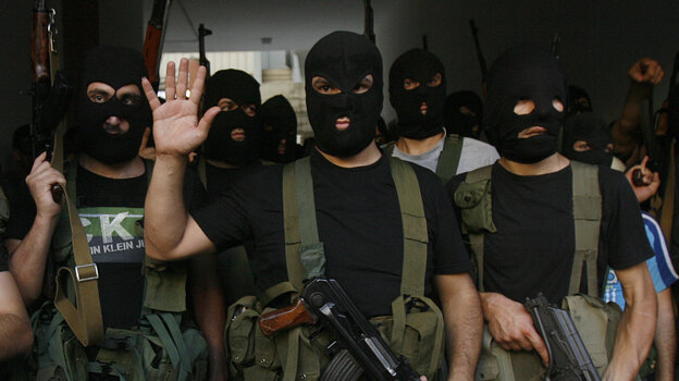 Lebanese masked gunmen from the al-Mokdad clan gather for a news conference in Beirut's southern suburbs on Aug. 15. The Mokdads, a large Lebanese Shiite Muslim clan, said they kidnapped at least 20 Syrians to try to secure
