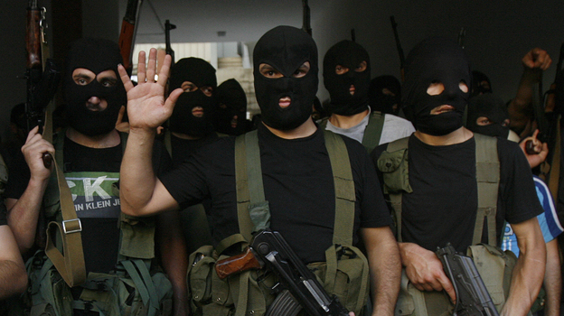 Lebanese masked gunmen from the al-Mokdad clan gather for a news conference in Beirut's southern suburbs on Aug. 15. The Mokdads, a large Lebanese Shiite Muslim clan, said they kidnapped at least 20 Syrians to try to secure the release of a family member abducted by Syrian rebels near Damascus this week. (AFP/Getty Images)