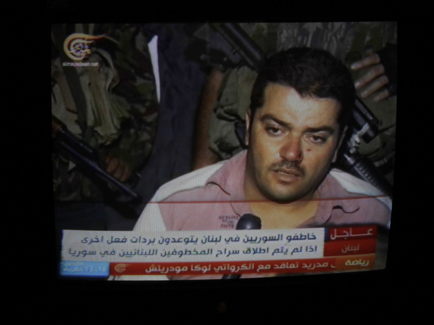 One of 20 Syrians kidnapped by the Mokdad family is seen in footage broadcast on Lebanese TV in Beirut, on Aug. 15.