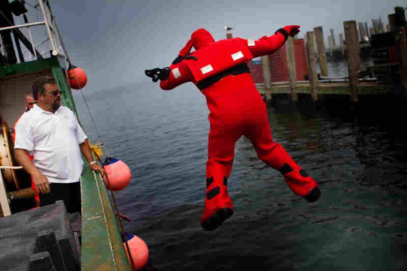 Mattera coaches a fisherman as he plunges into the water during a vessel disaster simulation.
