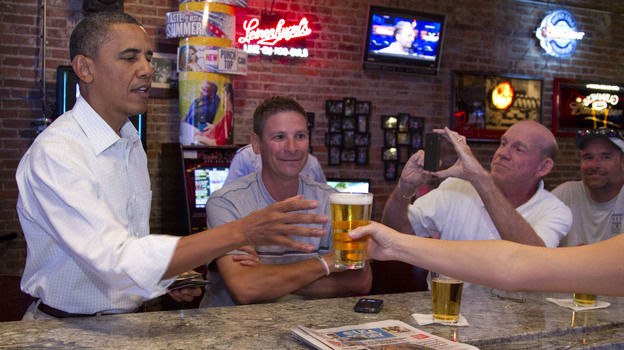 President Barack Obama enjoys a beer at The Pump House in Cedar Falls, Iowa, this month, but would you like to know what's in his homebrew? There's a petition for that. (AP)