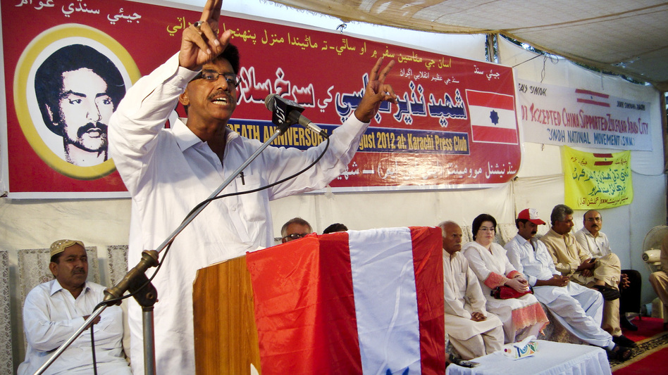 Ali Hassan, president of the Sindhi National Movement, speaks at an anti-China rally in Karachi on Aug. 9. Local activists were protesting the construction by China of an industrial megacity, Zulfiqarabad, in their province. (NPR)